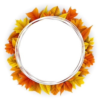 Round frame with autumn leaves on white background