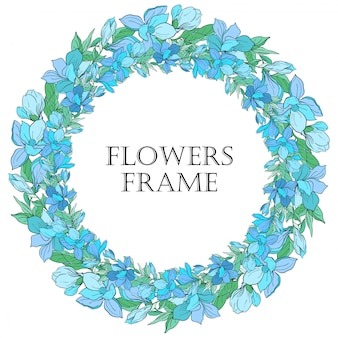 Round frame with flowers. blue magnolia flowers.