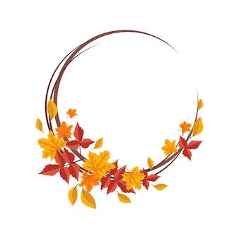 オレンジと黄色のカエデの葉の丸いフレームは、自然と枝の贈り物で明るい秋の花輪を残します...