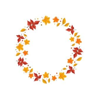 オレンジと黄色のカエデの葉の丸いフレームは、空の自然の贈り物で明るい秋の花輪を残します...