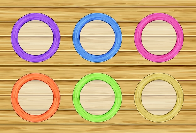 Round frames on wooden wall