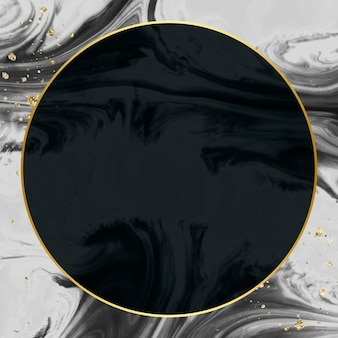 Round gold frame on abstract black watercolor