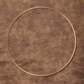 Round gold frame on brown leather background vector