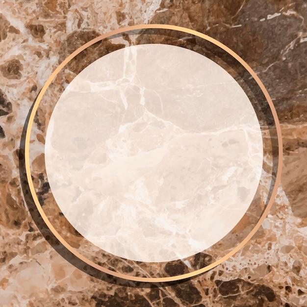 茶色の大理石の背景にラウンドゴールドフレーム