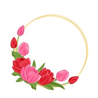 赤とピンクの春の花のチューリップとラウンドゴールドフレーム。