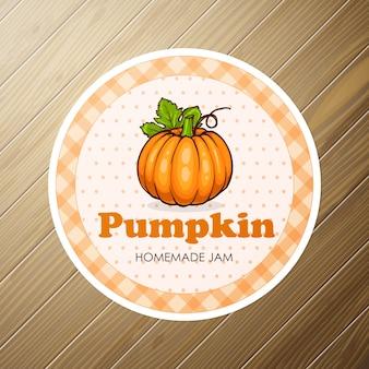 Round label, pumpkin jam on a wooden background