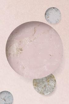 ピンクの大理石の織り目加工の背景に丸い模様