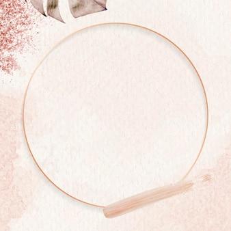 モンステラ リーフの背景を持つ丸いピンク ゴールド フレーム