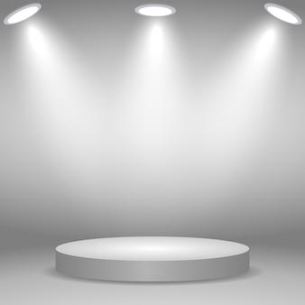 白のスポットライトで照らされた丸い表彰台、台座、またはプラットフォーム