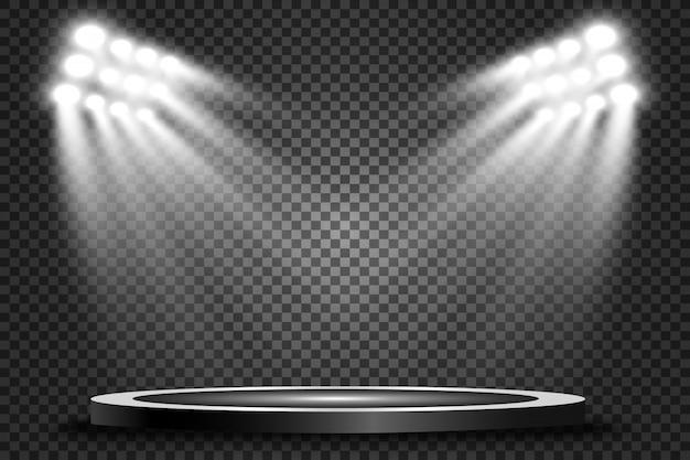 Round podium, pedestal or platform, illuminated by spotlights in the background.