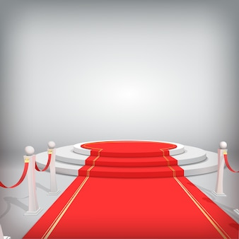Round podium with red carpet and barriers