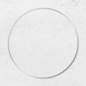 Round silver frame on cement textured background