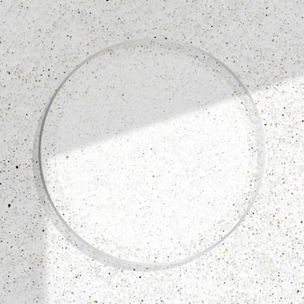 그림자 흰색 대리석 배경에 라운드 실버 프레임