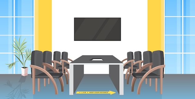 Round table meeting room with signs for social distancing yellow stickers coronavirus epidemic