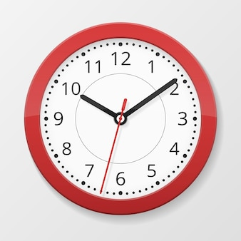 Round wall quartz clock in red color isolated on white background