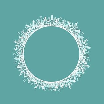 雪片で作られた丸い白いフレーム