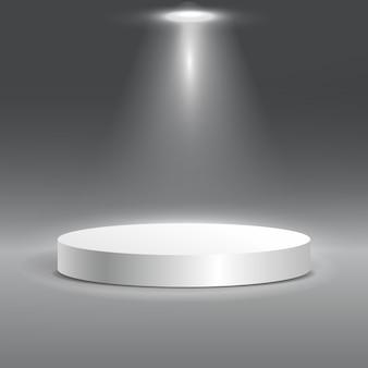 Round white stage podium illuminated with light.