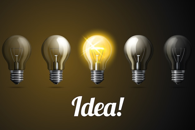 1つの明るく光る、現実的な電球の行。アイデアのコンセプト。