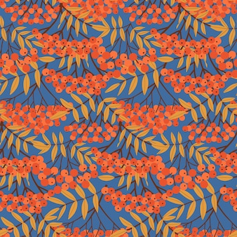 Rowan berry branches and leaves seamless pattern background with simple abstract hand drawn red berr...