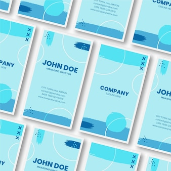 Rows and columns of hand painted business cards