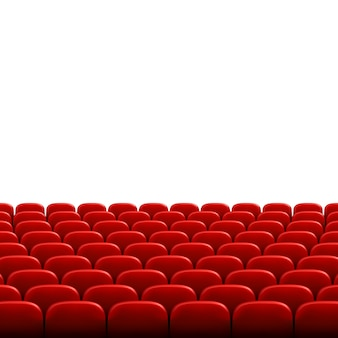 Rows of red cinema or theater seats in front of white blank screen. wide empty movie theater auditorium with red seats.