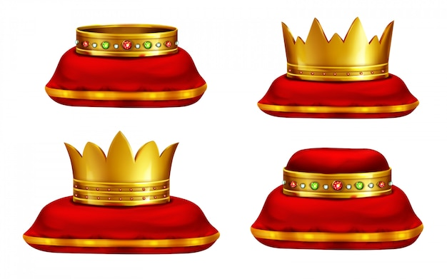 Royal golden crowns inlaid with precious gemstones lying on red ceremonial pillow
