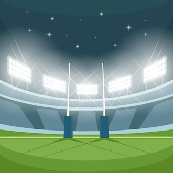 夜にライトが灯るラグビースタジアム。常夜灯、ゲームとゴール、明るい投光照明、スポットライトと地面、