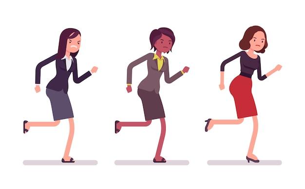 Runnig businesswomen in formal wear