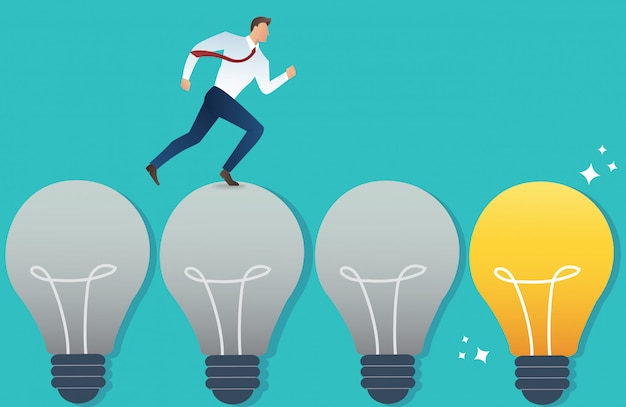 Running businessman on light bulb idea