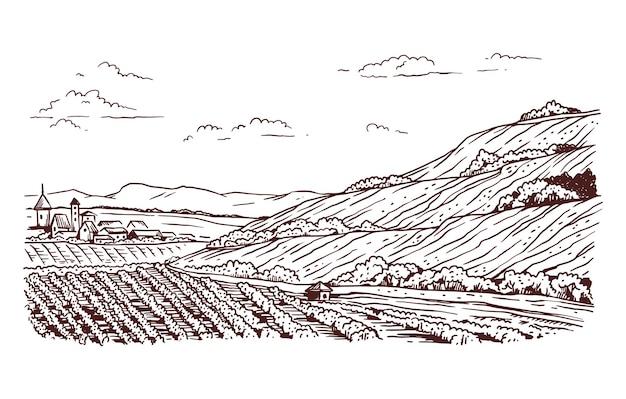 ブドウの木、丘、村の家のある田園風景。ブドウ畑が植えられた畑のある農業農場