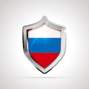 光沢のある盾として投影されたロシアの旗