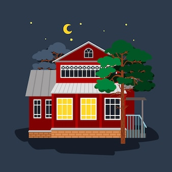 Деревенский коттедж с светом в окнах среди деревьев ночью