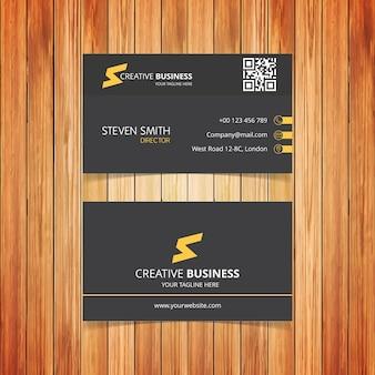 Sの文字のロゴ黒と黄色の最小企業名刺