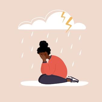 비오는 구름 아래 앉아 슬픈 아프리카 여자입니다. 울고 우울된 십 대입니다.
