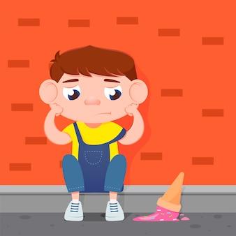 Грустный мальчик плачет от упавшего мороженого.