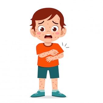 Sad cute kid boy get measles ill