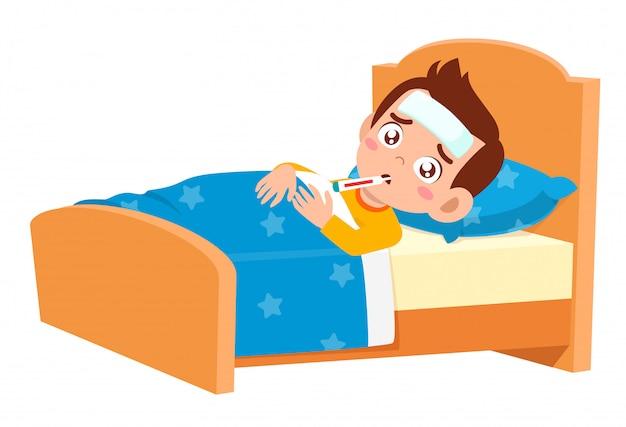 悲しいかわいい子供男の子は病気のベッドに横たわっていた