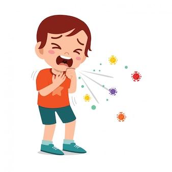 독감 때문에 슬픈 귀여운 꼬마 소년 재채기