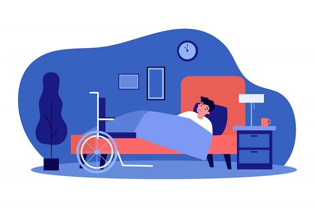 슬픈 장애인 젊은 남자가 침대에서 쉬고