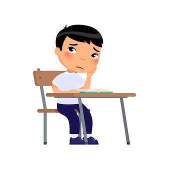 Triste studente di scuola elementare infelice piccolo scolaro asiatico