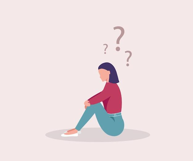 悲しい女の子。女の子は床に座って人生について考えます