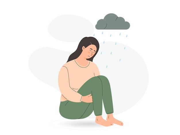 우울증을 없애기 위해 슬픈 외로운 여자 불행한 어린 소녀가 앉아서 무릎을 껴안습니다