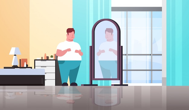 Sad  man looking at himself reflection in mirror guy over size obesity concept modern apartment