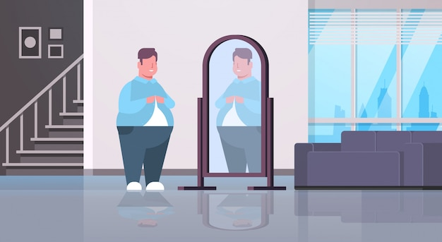 Sad  man looking at himself reflection in mirror over size guy buttoning shirt