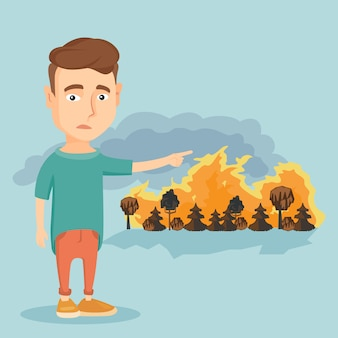 Sad man pointing to wildfire.