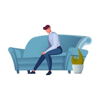 ソファフラットに座っている悲しい男