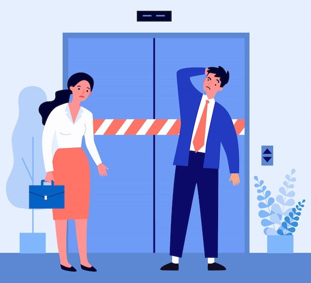 Sad man and woman standing in front of broken elevator