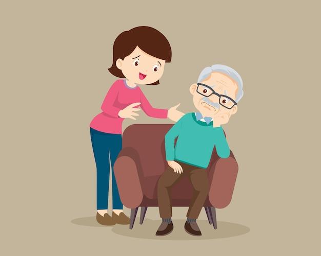 Печальный старший мужчина сидит и утешающая женщина расстраивает его