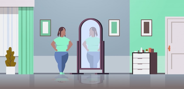 Sad  woman looking at herself reflection in mirror  girl concept modern home living room