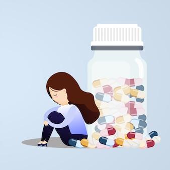 Грустная женщина сидит возле таблетки бутылки.
